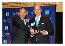 Dennis Johnson presenting leadership award to James Rickard
