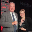 Melissa Currie, MD, with award presenter Judge David Holton
